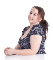 smiling fat beautiful young woman in dark dress