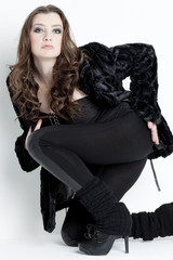kneeling young woman wearing black clothes