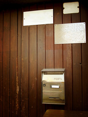 door with plates and mailbox