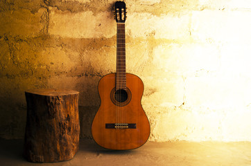 Acoustic guitar on old wall - copyspace