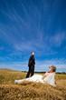 Beautiful couple on the yellow field