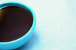 closeup of a blue coffee cup