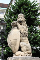 Lion statue with shield