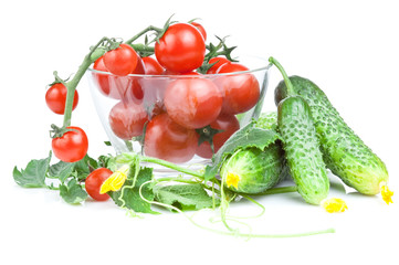 Cherry tomatoes in a salad bowl with flowers and cucumber leaves