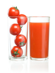 Cherry tomatoes inside of a glass and tomato juice