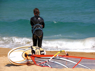 sportsman windsurfer  standing on seacoast
