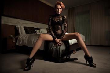 Elegant woman in hotel room