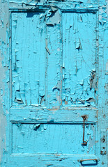 cracked old painted blue door
