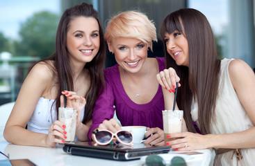 Three young women having coffee break