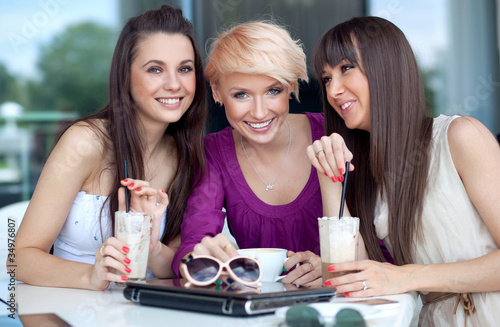 Three young women having coffee break