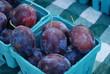 Fresh purple organic plums at a local Market