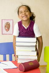 L'enfant et les devoirs d'école - le poids des livres scolaires