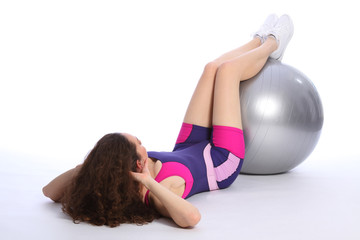 Fit young woman working out with exercise ball