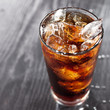 glass of cola with ice with copyspace in composition