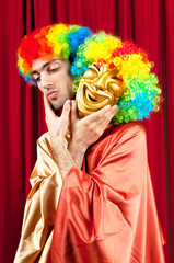 Actor with maks in a funny theater concept
