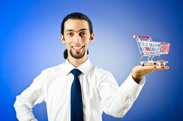 Business concept - Hands holding shopping cart