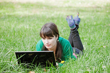 Active beautiful young sexy girl relaxing with laptop