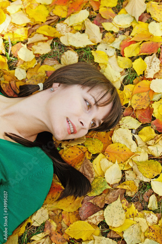 beautiful girl  resting on yellow autumn leaves
