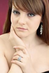 portrait of beautiful nacked girl with earrings