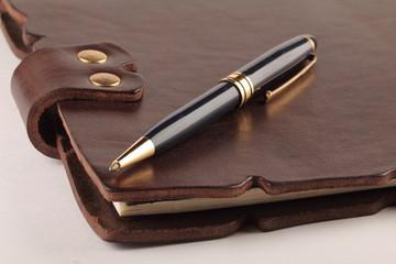 folder with a pen