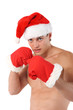Sexy muscular man wearing a Santa Claus hat