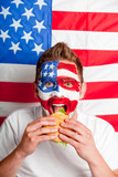 American man eating hamburger