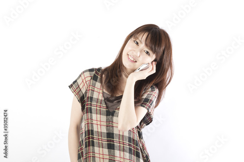 asian woman talking by mobile phone