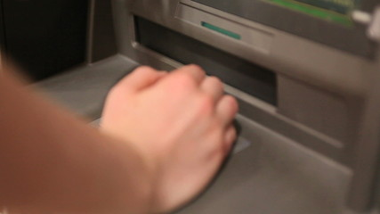 Person making a cash withdrawal