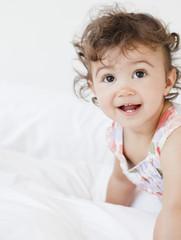 Hispanic baby girl crawling