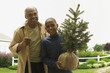 African grandfather and grandson planting tree