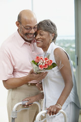 African man giving wife flowers