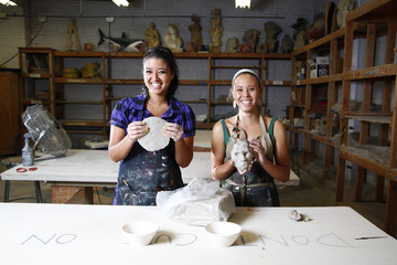 Women working with clay in artist studio
