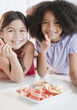 Girls eating fruits and vegetables for snack