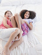 Girls playing in bed