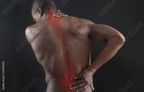 African American with glowing aches in back