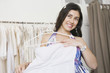 Hispanic woman shopping for wedding dress