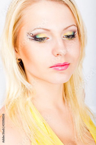 Young beautiful blonde woman with stylish make-up