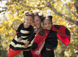 Black mother and daughters in Halloween costumes