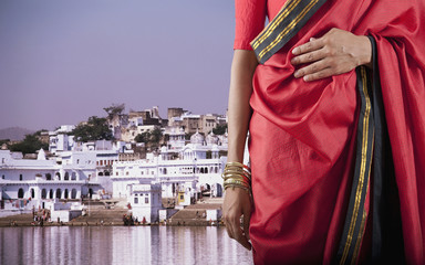 Indian woman in traditional clothing on waterfront