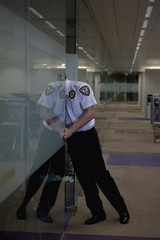 Hispanic security guard checking office