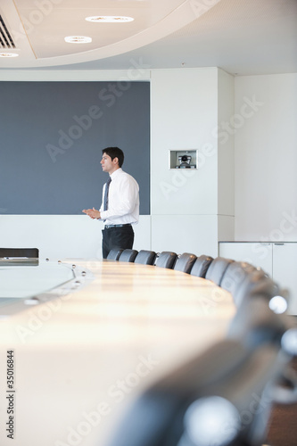 Hispanic businessman standing in conference room