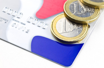 Euro coins close up on credit card