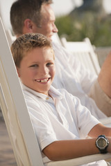 Smiling Caucasian boy sitting in chair