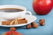 Coffee and apples on the blue background