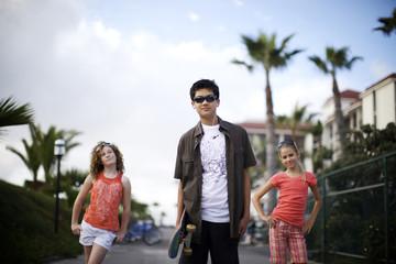Friends walking along urban sidewalk
