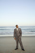 Black businessman standing on beach