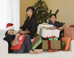Filipino family with stack of Christmas gifts
