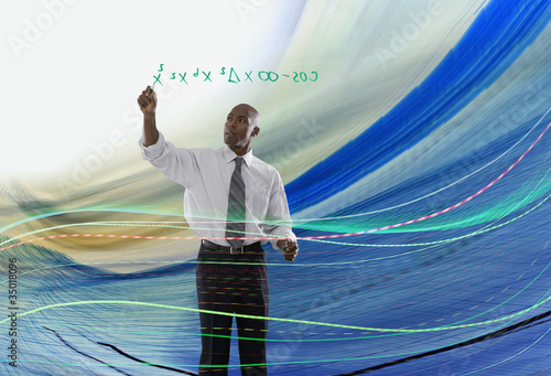 African American businessman writing formula on glass