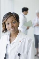 Black doctor in lab coat