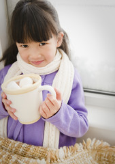 Chinese girl drinking hot chocolate